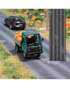 Busch asfaltweg met schade  h0 1105